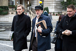 © Licensed to London News Pictures. 17/01/2016. London, UK. Labour party leader JEREMY CORBYN (centre)  arrives at BBC Broadcasting House with his adviser SEUMAS MILNE (left)  to appear on The Andrew Marr Show on BBC One. Photo credit: Ben Cawthra/LNP