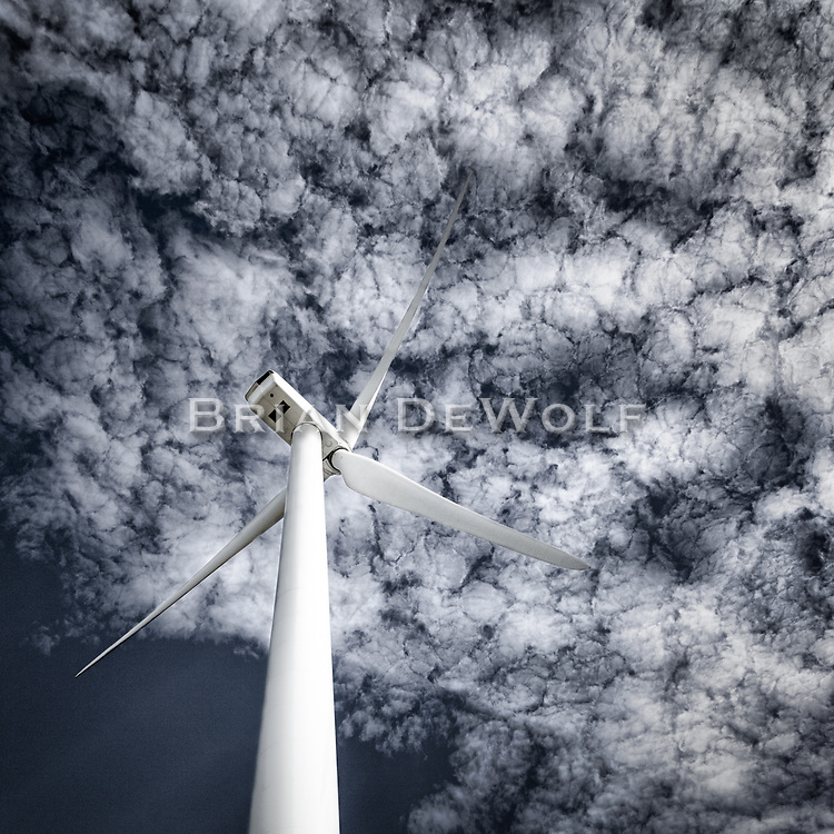 Blades whirling against a popcorn sky.