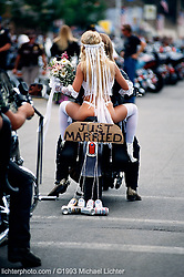 Just Married, Sturgis. SD. 1994<br /> <br /> Limited Edition Print from an edition of 50. Photo ©1994 Michael Lichter.<br /> <br /> The Story: I was just an innocent bystander as this wedding procession rode down Main Street.  Is there a side of everyone that wishes they were as unconventional as this couple appears to be?
