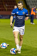 Shrewsbury Town Defender Charlie Daniels warms up before the EFL Sky Bet League 1 match between Lincoln City and Shrewsbury Town at Sincil Bank, Lincoln, United Kingdom on 15 December 2020.