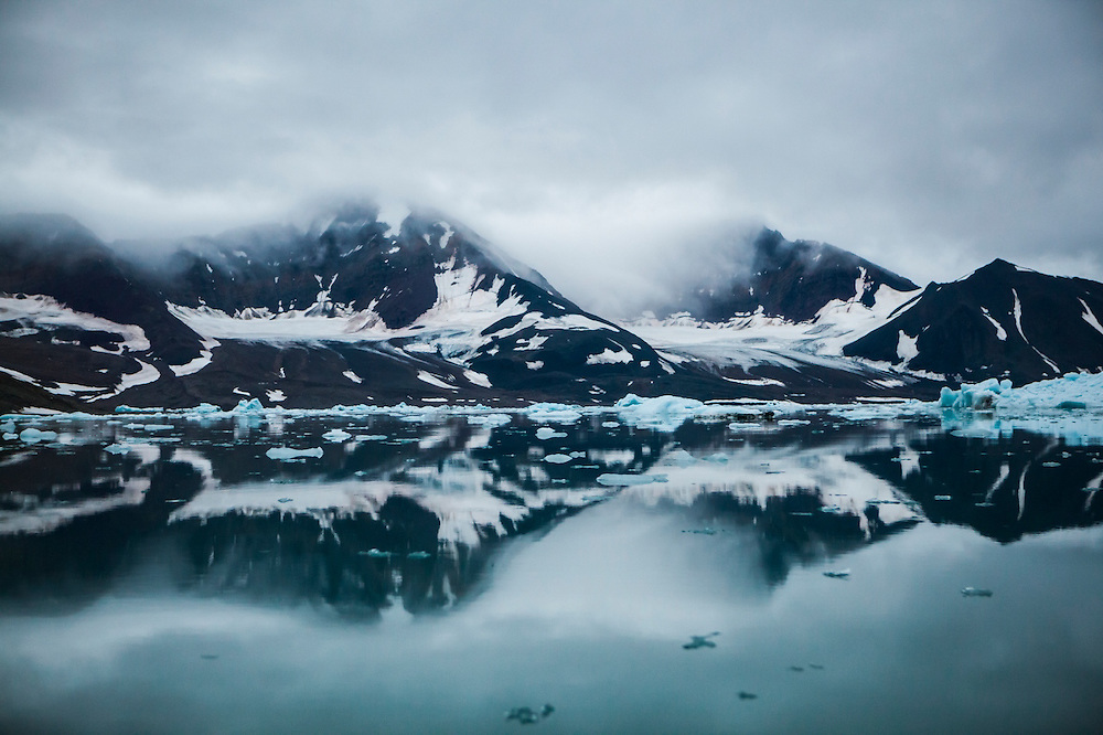 Hanging valley glaciers and floating icebergs in Hornsund, Svalbard.