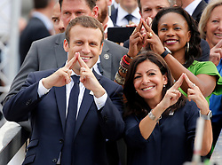 French President Emmanuel Macron (L) stands with city mayor Anne Hidalgo (R) and Sports Minister Laura Flessel (Top R) as they pose on an athletics track which floats on the Seine River in Paris, France, June 24, 2017. The French capital is transformed into a giant Olympic park to celebrate International Olympic Days with a variety of sporting events for the public across the city during two days as the city bids to host the 2024 Olympic and Paralympic Games. Photo by Jean-Paul Pelissier/Pool/ABACAPRESS.COM