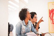 """SAN FRANCISCO, CA – SEPTEMBER 15, 2017: Incoming freshmen in the class of 2021 participate in a tour and discussion at the newly expanded San Francisco Museum of Modern Art. """"Co-curricular"""" programs like these are organized weekly in each global city as a compliment to the students' coursework, and are designed to facilitate active learning through the civic partnerships. Consistent with the """"flipped"""" classroom model, these experiential learning components are an embodiment of the Minerva ethos, where the city is the classroom. For incoming freshmen, San Francisco is the first of eight global cities to serve as a backdrop for their undergraduate education.<br /> <br /> Minerva is a unique 21st century university built on a global four-year education model. It is deliberately designed to enhance intellectual growth and prepare students for success in today's rapidly changing global context. Founded in 2014, the university targets the developing world's rising middle class who seek an elite American education. With a 2.8% acceptance rate among the founding class, Minerva is the most selective undergraduate program in U.S. history."""