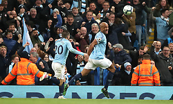 Manchester City's Vincent Kompany (right) celebrates scoring his side's first goal of the game during the Premier League match at the Etihad Stadium, Manchester.