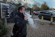 Man vaping, Battle Station,  East Sussex, . 3 February 2016