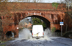 © Licensed to London News Pictures. 06/01/2014, Christchurch, UK. A van drives through a flooded road at Christchurch, England , Monday, Jan. 6, 2014. Part of UK continue to be affected by floods and strong wind. Photo credit : Sang Tan/LNP
