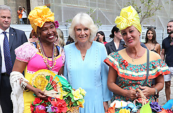 The Duchess of Cornwall poses with two well-wishers during a guided tour of Old Havana, in Havana, Cuba.