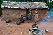 Central African Republic. August 2012. Batalimo. Pk6 - Aka (Biaka) people/ pygmies or 'citizens' as they would rather be known. Wattle and daub house with cooking fire outside.