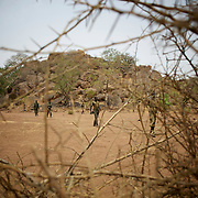 May 02, 2012 - Kauda, Nuba Mountains, South Kordofan, Sudan: A field commander of Sudan People's Liberation Movement (SPLA-N) walks by in Jebel Kwo military base near Tess village in the rebel-held territory of the Nuba Mountains in South Kordofan. SPLA-North, a historical ally of SPLA, South Sudan's former rebel forces, has since last June being fighting the Sudanese Army Forces (SAF) over the right to autonomy and of the end of persecution of Nuba people by the regime of President Bashir.