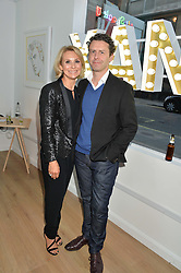ROBERTA MOORE daughter of West Ham United and England's legendary captain, Bobby Moore and MATT MOORE at a private view of an exhibition entitled 'All Shook Up' - by Natasha Archdale: A Retrospective held at 90 Piccadilly, London on 23rd April 2015.