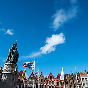 The skyline of one side of the Markt (Market Square) in the historic center of Bruges, a UNESCO World Heritage site. At bottom left is the famous statue of Jan Breydel and Pieter de Coninck, two Flemish heroes from the early 14th century.