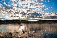 The sun sets over fishing boats in Grand Manan Island, New Brunswick, Canada