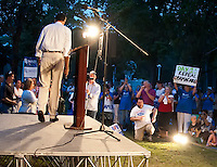 Mitt Romney leaves the stage following his speech to the crowd gathered at Rollins Park in Concord for the Tea Party Express Tour Sunday evening.  (Karen Bobotas/for the Concord Monitor)