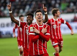 WOLFSBURG, Feb. 18, 2018  Bayern Munich's Robert Lewandowski (Front) celebrates his scoring during a German Bundesliga match between VfL Wolfsburg and Bayern Munich, in Wolfsburg, Germany, on Feb. 17, 2018. Bayern Munich won 2-1. (Credit Image: © Shan Yuqi/Xinhua via ZUMA Wire)
