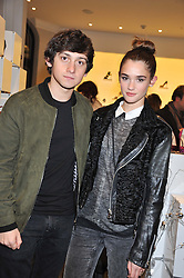 CRAIG ROBERTS and SAI BENNETT at a party to celebrate the launch of a limited edition shoe The Chambord in celebration of Nicholas Kirkwood's partnership with Chambord black raspberry liqueur, held at the Nicholas Kirkwood Boutique, 5 Mount Street, London on 12th December 2012.