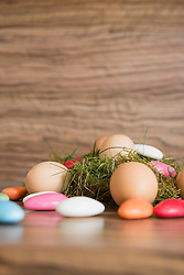 Close-up of Easter eggs with Colourful candies and bird nest