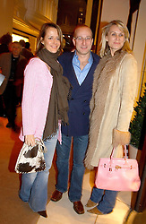Left to right, HELENA BURTON, PAUL MCKENNA and CLARE STAPLES at a party to celebrate the 2nd anniversary of Quintessentially magazine held at Asprey, Bond Street, London on 24th February 2005.<br /><br />NON EXCLUSIVE - WORLD RIGHTS