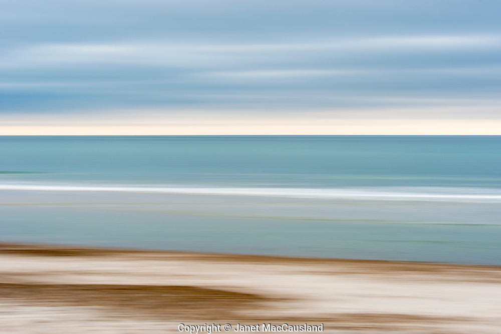 Softness and peacefulness are expressed in this abstract seascape. The colors would compliment the walls of many homes. it is made with a practiced technique of moving the camera while exposing the image.