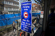 Aerial view of a bus stop and TFL Congestion Charging Zone sign, seen from the top deck of a London bus, outside King's College Hospital.