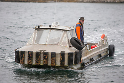 The Ulva ferry on way tp pick people up. Feature on the community on the island of Ulva, who have been awarded £4.4m in funding for their island buyout.