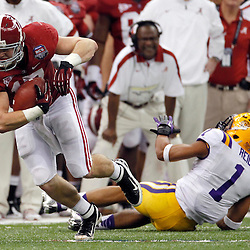 Jan 9, 2012; New Orleans, LA, USA; Alabama Crimson Tide tight end Brad Smelley (17) runs past LSU Tigers safety Eric Reid (1) during the second half of the 2012 BCS National Championship game at the Mercedes-Benz Superdome.  Mandatory Credit: Derick E. Hingle-US PRESSWIRE