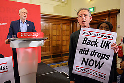 © Licensed to London News Pictures. 10/12/2016. London, UK. Labour leader and the leader of opposition JEREMY CORBYN is interrupted by PETER TATCHELL and 'Syria Solidarity UK' protesters whilst speaking on human rights at the Methodist Central Hall in Westminster, London on Saturday, 10 December 2016. Photo credit: Tolga Akmen/LNP