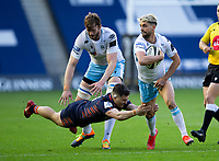 Rugby Union - 2021 Guinness Pro14 Rainbow Cup - Northern Group - Edinburgh vs Glasgow Warriors - Murrayfield<br /> <br /> Adam Hastings of Glasgow Warriors is tackled by Mike Willlemse of Edinburgh Rugby<br /> <br /> Credit : COLORSPORT/BRUCE WHITE