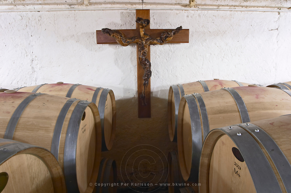 barrel aging cellar old vine looking like crucifix chateau le bourdillot graves bordeaux france