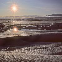 The midnight sun circles over frozen Eclipse Sound north of Baffin Island, Nunavut, Canada.