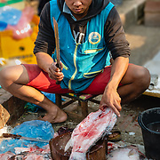Fishmonger at morning market in Luang Prabang
