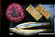 "Among the treats in the menu at a ""longevity restaurant"" (an eatery claiming to serve food that will make patrons live longer) in Ogimi Village, Okinawa, are silver sprat fish, chopped vegetables and crispy rice flour, and purple Okinawan potatoes. (Supporting image from the project Hungry Planet: What the World Eats.) Hara hachi bu: ""eat only until 80 percent full,"" say older Okinawans. The island has been the focus in recent years of researchers trying to discover why a disproportionately large number of Okinawans are living to age 100 or more."