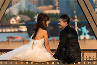 Shanghai, China - April 7, 2013: young wedding couple on The Waibaidu Bridge at the city of Shanghai in China on april 7th, 2013