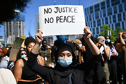 © Licensed to London News Pictures. 31/05/2020. London, UK. Demonstrators gather in front of the US Embassy in London, protesting the police killing of George Floyd, an unarmed black man in Minneapolis who died in police custody while an officer kneeled on his neck to pin him down. Photo credit: Guilhem Baker/LNP