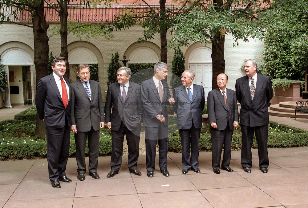 The finance ministers from the Group of Seven nations talk among themselves as they pose for a group photo in the courtyard at Blair House October 3, 1998 in Washington, DC. From left: The United Kingdom's Chancellor of the Exchequer Gordon Brown; German Director General, Ministry of Finance Klaus Regling; French Minister of Economy and Finance Dominique Strauss-Kahn; U.S. Secretary of the Treasury Robert Rubin; Italian Minister of the Treasury Carlo Ciampi; Japanese Minister of Finance Kiichi Miyazawa and Canada's Minister of Finance Paul Martin.