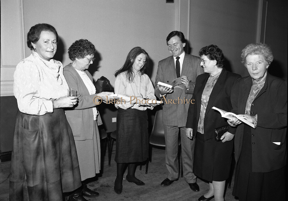"""""""These Obstreperous Lassies"""" Book Launch.  (R93)..1988..15.12.1988..12.15.1988..15th December 1988..A book which chronicles an important aspect of Irish social history was launched in Larkin Hall. """"These Obstreperous Lassies"""" written and researched by Mary Jones, details the seventy three years of the Irish Women Workers Union and of the women who were involved in the union..With Countess Markievicz as its first president, The Union began the fight for equal pay and fair treatment under the leadership of women like helen Chenevix, Louise Bennett and Helena Molloy. They fought for the rights of vulnerable workers such as Laundresses,print workers,box makers,nurses and dressmakers..The Author, Mary Jones, is a full time researcher specialising in Women and Work...Picture shows the Author Mary Jones autographing copies of her book """"These Obstreperous Lassies""""at its launch."""