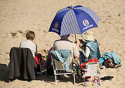 © Licensed to London News Pictures. 28/03/2012..Saltburn, England..As temperatures rise this week the beach at Saltburn in Cleveland attracts the visitors as they enjoy the warm weather...Photo credit : Ian Forsyth/LNP