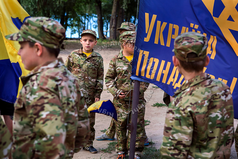 Youngsters participating to the ultra-nationalistic Azovets children's camp are standing around Azov flags, on the banks of the Dnieper river in Kiev Ukraine's capital.