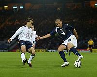 Photo: Andrew Unwin.<br />Scotland v USA. International Challenge. 12/11/2005.<br />Scotland's Nigel Quashie (R) looks to turn the USA's Steve Cherundolo (L).