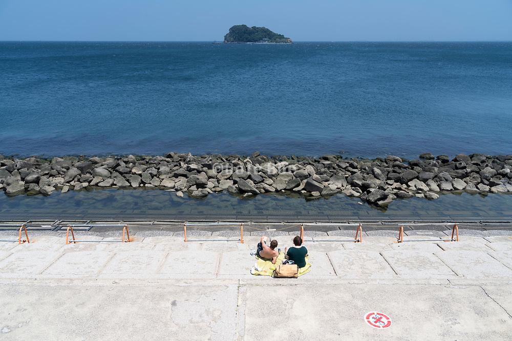 couple relaxing on a hot sunny day Tokyo Bay Yokosuka Japan