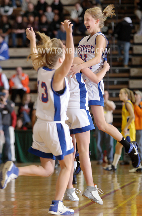 Troy, NY - Hoosic Valley girls' basketball players celebrate their victory at the Class B state semifinals at Hudson Valley Community College on March 14, 2008.