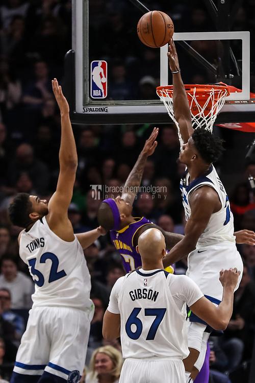 Feb 15, 2018; Minneapolis, MN, USA; Minnesota Timberwolves guard Jimmy Butler (23) blocks Los Angeles Lakers guard Isaiah Thomas (7) during the fourth quarter at Target Center. Mandatory Credit: Brace Hemmelgarn-USA TODAY Sports