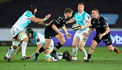 Ospreys' Dan Biggar offloads<br /> <br /> Photographer Simon King/Replay Images<br /> <br /> Guinness PRO14 Round 19 - Ospreys v Connacht - Friday 6th April 2018 - Liberty Stadium - Swansea<br /> <br /> World Copyright © Replay Images . All rights reserved. info@replayimages.co.uk - http://replayimages.co.uk
