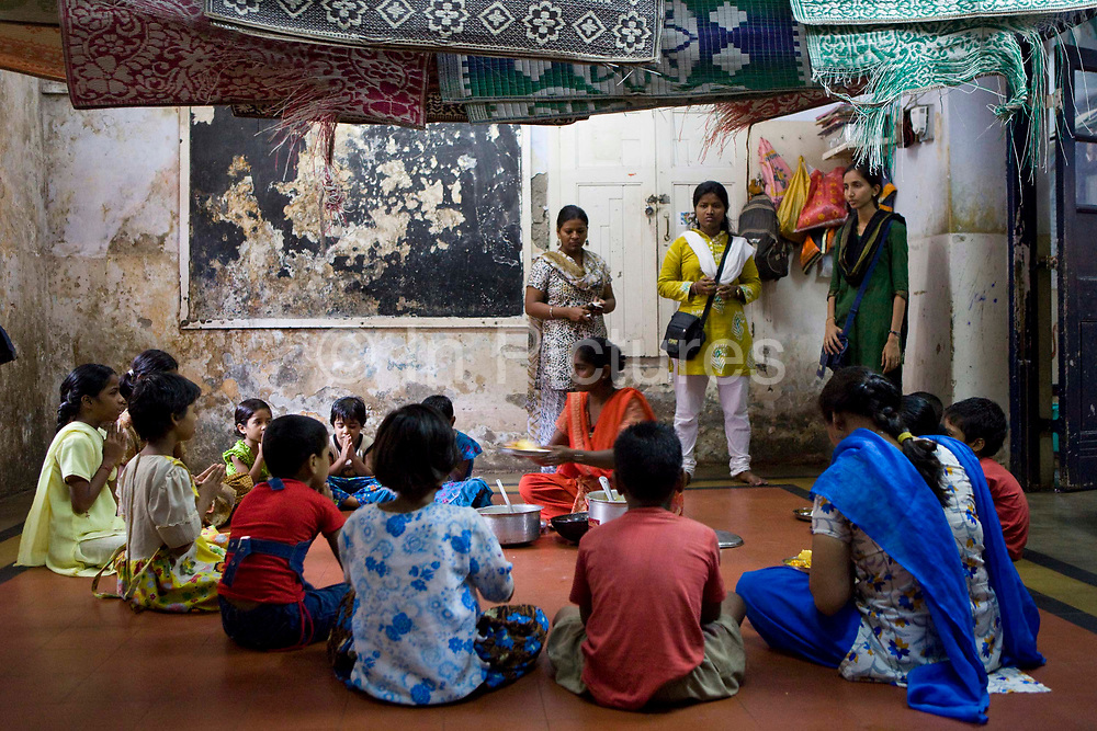 Lunch is provided for all the children at the Kamatipura Centre, Mumbai. The centre welcomes about 100 children every day from the surrounding red-light district. The centre is run by the Prerana organisation who specialise in children of the red-light districts in Mumbai.