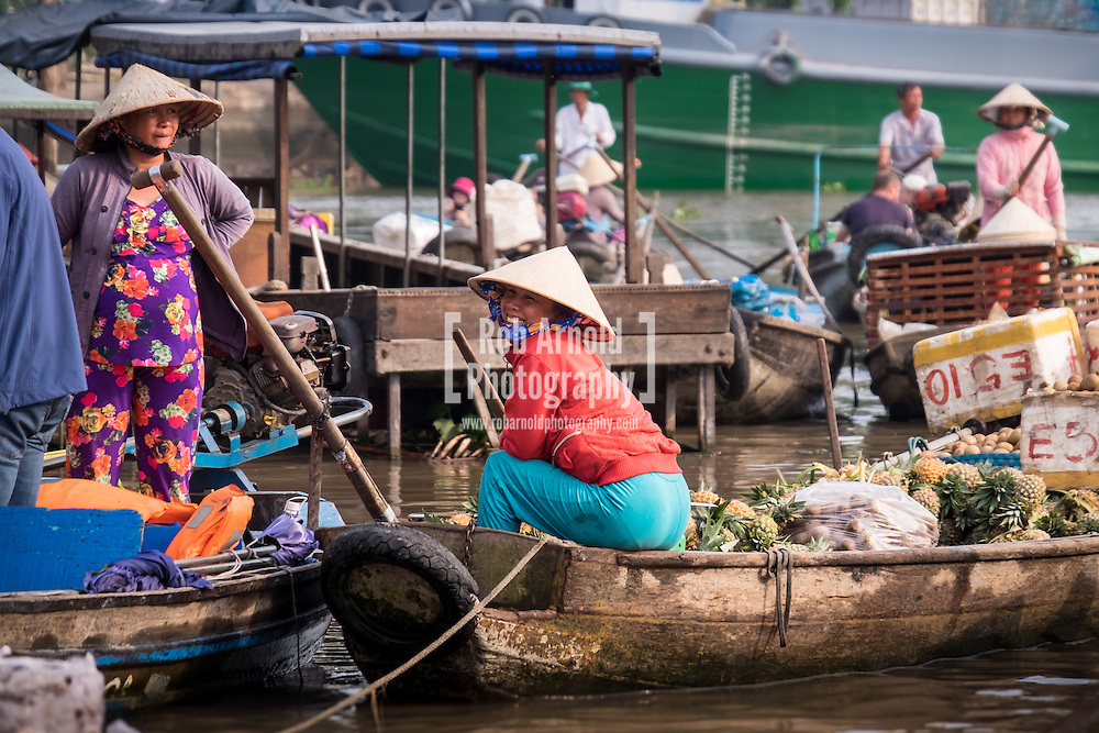 Morning activity at Phong Dien Floating Market on the Can Tho River in the Mekong Delta region of Vietnam