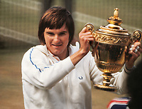 Tennis - 1974 Wimbledon Championships. Mens singles final.  Jimmy Connors v Ken Rosewal<br /> <br /> Jimmy Connor with the trophy<br /> <br /> <br /> l Credit : Colorsport / Mike Wall