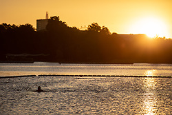 © Licensed to London News Pictures. 01/10/2018. London, UK. A swimmer in the Serpentine Lido in Hyde Park at sunrise this morning. Temperatures in the capital were cold this morning, but are set to reach over 20 degrees Celsius later this week, higher than average for the time of year. Photo credit : Tom Nicholson/LNP
