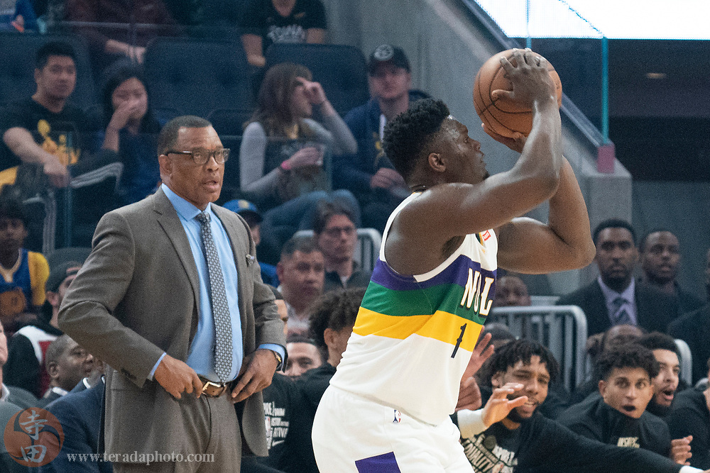 February 23, 2020; San Francisco, California, USA; New Orleans Pelicans forward Zion Williamson (1) shoots the basketball in front of head coach Alvin Gentry (left) during the first quarter against the Golden State Warriors at Chase Center.