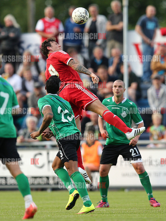 FOOTBALL: Darius Henderson (Nottingham Forest) jumps for the ball during the pre-season match between FC Helsingør and Nottingham Forest at Helsingør Stadion on July 14, 2015 in Helsingør, Denmark. Photo: Claus Birch / ClausBirch.dk