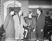03/02/1959.02/03/1959.03 February 1959.Cecil vard with the Simca Aronde he drove in the 1959 Monte Carlo Rally at Brown Thomas raising money for St Michael's House school for mentally handicapped children.