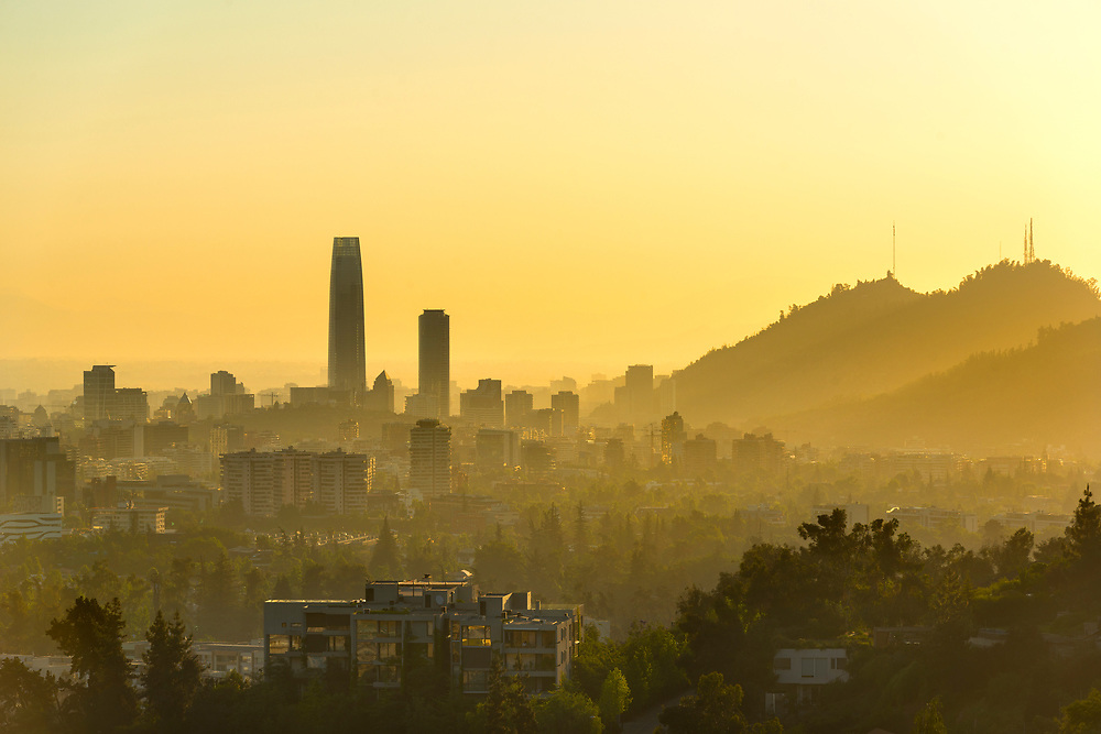 A silhouetted panoramic view of Santiago de Chile at sunset.